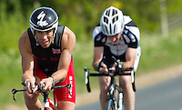 26 MAY 2013 - BRIGG, GBR - Phil Westoby (Elite 23-39) (left) of the Army Triathlon Association on the bike during the 2013 Brigg Bomber Quadrathlon, a World Quadrathlon Federation World Cup round and the British Championships, held in Brigg, Lincolnshire, Great Britain (PHOTO (C) 2013 NIGEL FARROW)