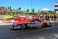 May 22, 2011; Topeka, KS, USA: NHRA pro stock driver V. Gaines (near lane) along side Rodger Brogdon during the Summer Nationals at Heartland Park Topeka. Mandatory Credit: Mark J. Rebilas-