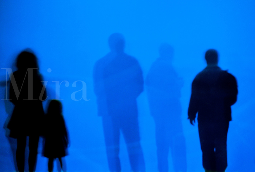 Silhouettes of people with ghost image
