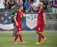 Commerce City, CO - Thursday June 08, 2017: Christian Pulisic, Michael Bradley during a 2018 FIFA World Cup Qualifying Final Round match between the men's national teams of the United States (USA) and Trinidad and Tobago (TRI) at Dick's Sporting Goods Park.