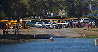 The seaplane ramp at the Clear Lake Seaplane Splash-In, Lakeport, Lake County, California is temporarily closed as pilots and mechanics assist Kent Carlomagno with a gear issue with his Seamax M-22, N153KC.