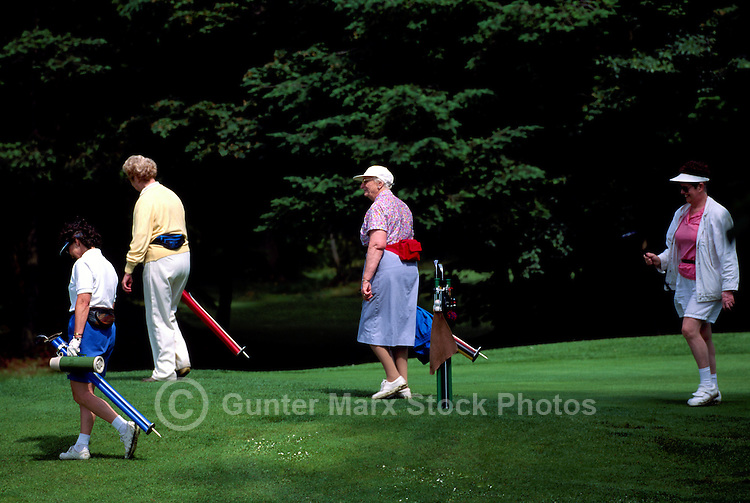Burnaby, BC, British Columbia, Canada - Active Senior Women Golfers walking with Golf Clubs at Central Park Golf Course