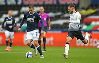 3rd October 2020; Liberty Stadium, Swansea, Glamorgan, Wales; English Football League Championship, Swansea City versus Millwall; Jed Wallace of Millwall brings the ball forward while under pressure from Matt Grimes of Swansea City