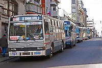 A row of buses on a city street. Montevideo, Uruguay, South America