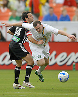 International friendly DC United vs Celtic FC. DC United midfielder Ben Olsen (14) tackling Celtic foward Craig Beattle (37) during the game, DC United defeated Celtic FC 4-0,  Wednesday, July 12, 2006 at RFK Stadium, Washington, DC.