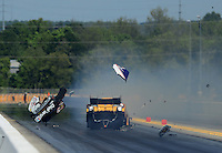 Apr. 13, 2012; Concord, NC, USA: NHRA funny car driver Jeff Arend drives through debris from the car of Matt Hagan (not pictured) after he exploded the body off his car during qualifying for the Four Wide Nationals at zMax Dragway. Mandatory Credit: Mark J. Rebilas-