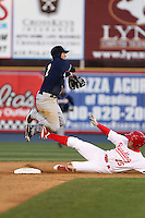 New Hampshire Fisher Cats second baseman Ryan Goins #2 attempts to turn a double play as Steve Susdorf #25 slides in during a game against the Reading Phillies at FirstEnergy Stadium on April 10, 2012 in Reading, Pennsylvania.  New Hampshire defeated Reading 3-2.  (Mike Janes/Four Seam Images)