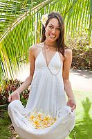 Beautiful Hawaiian woman carrying hand-picked plumerias to make a lei