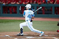 Angel Zarate (40) of the North Carolina Tar Heels follows through on his swing against the North Carolina State Wolfpack at Boshamer Stadium on March 27, 2021 in Chapel Hill, North Carolina. (Brian Westerholt/Four Seam Images)