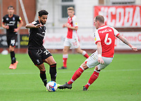 Lincoln City's Liam Bridcutt vies for possession with Fleetwood Town's Glenn Whelan<br /> <br /> Photographer Chris Vaughan/CameraSport<br /> <br /> The EFL Sky Bet League One - Fleetwood Town v Lincoln City - Saturday 17th October 2020 - Highbury Stadium - Fleetwood<br /> <br /> World Copyright © 2020 CameraSport. All rights reserved. 43 Linden Ave. Countesthorpe. Leicester. England. LE8 5PG - Tel: +44 (0) 116 277 4147 - admin@camerasport.com - www.camerasport.com
