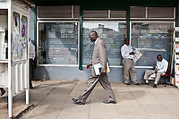 Detective patrick Simiyu onthe streets of Nairobi. He joked that the street we were on was the safest in Nairobi. It is  the pedestrian corridor between Central police station and the law courts.
