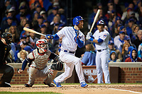 Chicago Cubs Ben Zobrist (18) hits a single in front of catcher Roberto Perez in the second inning during Game 5 of the Major League Baseball World Series against the Cleveland Indians on October 30, 2016 at Wrigley Field in Chicago, Illinois.  (Mike Janes/Four Seam Images)