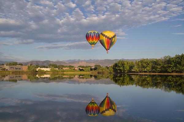 Hot air balloon and reflection in lake, Boulder, Colorado, USA.