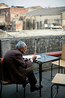 An elderly man eats his lunch on the roof terrace of the Indian coffee house, Baba Kharak Singh Marg. The coffee house dates back almost fifty years, first in central Connaught Place, then Janpath and now at the top of a rather shabby shopping centre. Where it is still run by the Indian Coffee Workers Cooperative Society. Once a regular haunt for politicos in Delhi, its clientele is still renowned for being well-read and intellectual.