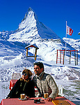 Switzerland, Valais, Zermatt, Couple at Cafe Riffelberg and Matterhorn Mountain (4.478 m)