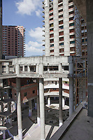 """In 1990 Venezuelan banker David Brillembourg began to build a forty storey, glass-clad skyscraper in Caracas, crowned by an heliport, aimed to  transform a part of downtown Caracas into a Wall Street-style financial district. Brillembourg , also known as  """"King David"""", spent in """"David's Tower"""" project  a part of the fortune he got in the stock markets in the 8o´s.<br /> David  died in 1993. One year later, his financial emporium  Confinanzas, managed by one of his sons, went bankrupt, in a black year for Venezuelan banks. <br /> Immediately the work progress at David´s Tower interrupted, and never resumed.  The project sunk in a legal swamp, managed by a state institution that tried a couple of unsuccessfully auctions.<br /> In 2007 people with housing problems invaded the towers and created a cooperative to keep some order and services inside, called Caciques de Venezuela. Now about 2.500 squatters live in David´s Tower, probably the largest invaded building of Latin America. Massive, impressive, seen from everywhere, David´s Tower is a symbol of projects never ended, promises never completed, decay."""