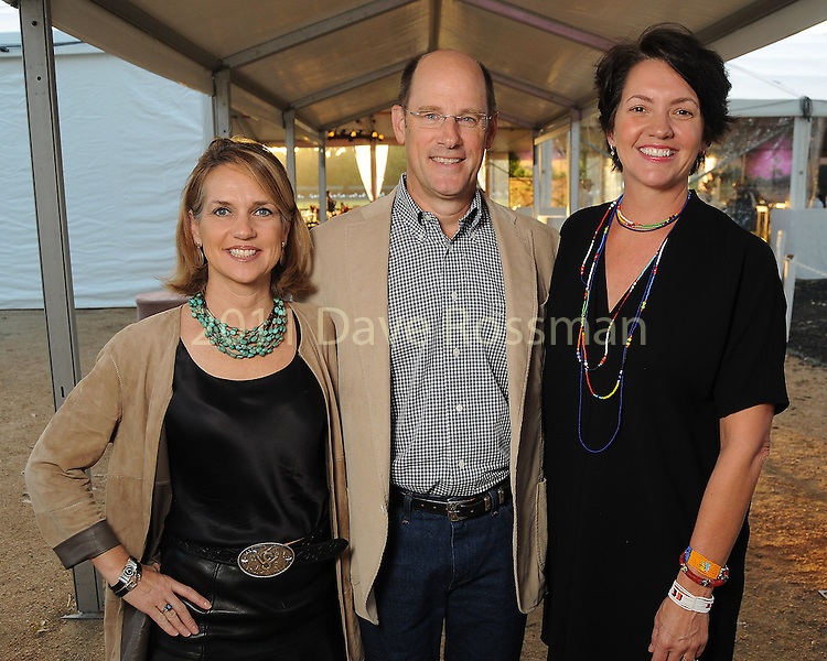 From left: Chairs Alie and David Pruner with state director of The Nature Conservancy in Texas, Laura Huffman at the Nature Conservancy's Nature Rocks  Gala at the Houston Polo Club Thursday Oct. 22,2015.(Dave Rossman photo)