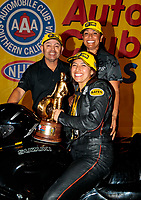 Nov 17, 2019; Pomona, CA, USA; NHRA pro stock motorcycle rider Jianna Salinas celebrates with father Mike Salinas and mother Monica Salinas after winning the Auto Club Finals at Auto Club Raceway at Pomona. Mandatory Credit: Mark J. Rebilas-USA TODAY Sports