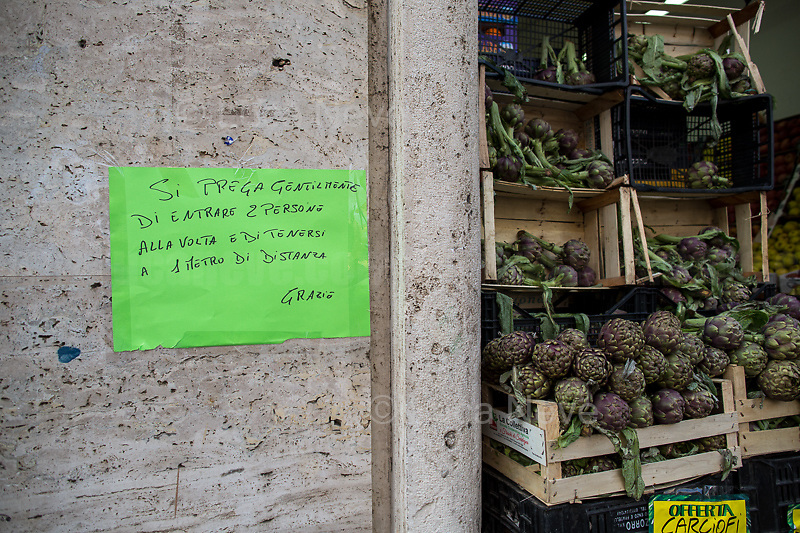 """Food shop: open. <br /> <br /> Prologue, Rome - Flaminio District, 10/03/2020.   <br /> <br /> Rome, 12/03/2020. Documenting Rome under the Italian Government lockdown for the Outbreak of the Coronavirus (SARS-CoV-2 - COVID-19) in Italy. On the evening of the 11 March 2020, the Italian Prime Minister, Giuseppe Conte, signed the March 11th Decree Law """"Step 4 Consolidation of 1 single Protection Zone for the entire national territory"""" (1.). The further urgent measures were taken """"in order to counter and contain the spread of the COVID-19 virus"""" on the same day when the WHO (World Health Organization, OMS in Italian) declared the coronavirus COVID-19 as a pandemic (2.).<br /> ISTAT (Italian Institute of Statistics) estimates that in Italy there are 50,724 homeless people. In Rome, around 20,000 people in fragile condition have asked for support. Moreover, there are 40,000 people who live in a state of housing emergency in Rome's municipality.<br /> March 11th Decree Law (1.): «[…] Retail commercial activities are suspended, with the exception of the food and basic necessities activities […] Newsagents, tobacconists, pharmacies and parapharmacies remain open. In any case, the interpersonal safety distance of one meter must be guaranteed. The activities of catering services (including bars, pubs, restaurants, ice cream shops, patisseries) are suspended […] Banking, financial and insurance services as well as the agricultural, livestock and agri-food processing sector, including the supply chains that supply goods and services, are guaranteed, […] The President of the Region can arrange the programming of the service provided by local public transport companies […]».<br /> Updates: on the 12.03.20 (6:00PM) in Italy there 14.955 positive cases; 1,439 patients have recovered; 1,266 died.<br /> <br /> Footnotes & Links:<br /> Info about COVID-19 in Italy: http://bit.do/fzRVu (ITA) - http://bit.do/fzRV5 (ENG)<br /> 1. March 11th Decree Law http://bit.do/fzREX (ITA) - http://b"""