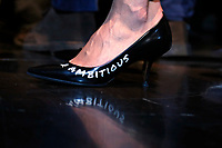 A journalist wearing shoes with written ambitious<br /> Rome February 16th 2020. Convention 'Salvini meets Rome'.<br /> Foto Samantha Zucchi Insidefoto