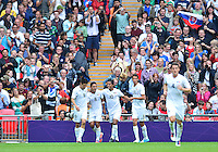 August 07, 2012..Mexico's Marco Fabian is congratulated by teammates after scoring against Japan during Semi Final match at the Wembley Stadium on day eleven in Wembley, England. Mexico defeat Japan 3-1 to reach Men's Finals of the 2012 London Olympics...