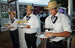 Members of the waitstaff at the Nature Conservancy's Nature Rocks  Gala at the Houston Polo Club Thursday Oct. 22,2015.(Dave Rossman photo)