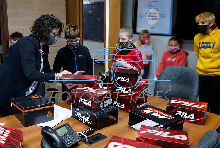 Peggy Sweetland sorts new shoes for students at Seeliger Elementary during the Step into Spring program through the McKinney-Vento program at the Carson City School District, in Carson City, Nev., on Tuesday, April 27, 2021.<br /> Photo by Cathleen Allison