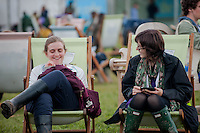 Tuesday 27 May 2014, Hay on Wye, UK<br /> Pictured: Two Girls share a joke at the Hay festival <br /> Re: The Hay Festival, Hay on Wye, Powys, Wales UK.
