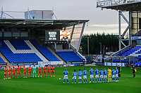 Blackpool and Peterborough United players during a minutes' applause in tribute to Warren Green, Blackpool's academy manager, who died aged 46<br /> <br /> Photographer Chris Vaughan/CameraSport<br /> <br /> The EFL Sky Bet League One - Peterborough United v Blackpool - Saturday 21st November 2020 - London Road Stadium - Peterborough<br /> <br /> World Copyright © 2020 CameraSport. All rights reserved. 43 Linden Ave. Countesthorpe. Leicester. England. LE8 5PG - Tel: +44 (0) 116 277 4147 - admin@camerasport.com - www.camerasport.com