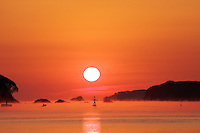 Sunrise over the ocean on a cold day, mist rising into the orange sky. A small boat between the buoys, a fisherman heading out to check the nets amidst the dark islands that surround the bay. Impossibly beautiful, heartbreaking, the Tohoku after the tsunami. <br /> <br /> (title translation by David Landis Barnhill)