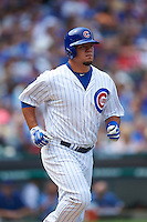 Chicago Cubs outfielder Kyle Schwarber (12) jogs to first during a game against the Milwaukee Brewers on August 13, 2015 at Wrigley Field in Chicago, Illinois.  Chicago defeated Milwaukee 9-2.  (Mike Janes/Four Seam Images)