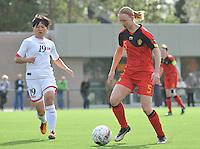 Belgium A - North Korea friendly game at Koksijde KVV Stadium - Belgie - Noord Korea : .Inge Heiremans aan de bal voor 19. Kwon Song Mwa.foto David Catry / Joke Vuylsteke / Vrouwenteam.be