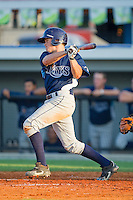 Geno Glynn #37 of the Princeton Rays follows through on his swing against the Burlington Royals at Burlington Athletic Stadium July 11, 2010, in Burlington, North Carolina.  Photo by Brian Westerholt / Four Seam Images