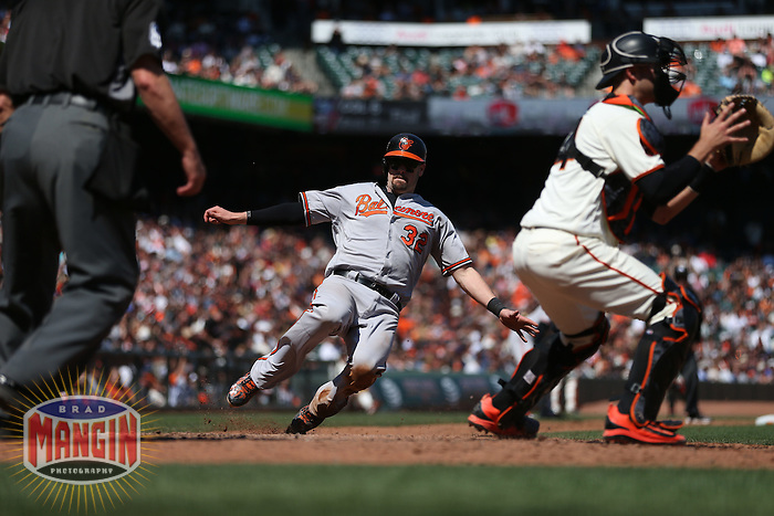 SAN FRANCISCO, CA - AUGUST 14:  Matt Wieters #32 of the Baltimore Orioles slides home safely against the San Francisco Giants as Giants catcher Trevor Brown #14 takes the late throw during the game at AT&T Park on Sunday, August 14, 2016 in San Francisco, California. Photo by Brad Mangin