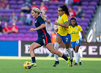 ORLANDO, FL - FEBRUARY 21: Lindsey Horan #9 of the USWNT dribbles during a game between Brazil and USWNT at Exploria Stadium on February 21, 2021 in Orlando, Florida.