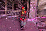 A man dozes off after drinking Vang on the occassion of Holi in Vrindavan. Holi - The  Hindu festival of colour is celibrated for a week in the Brraj region of Uttar Pradesh, India.