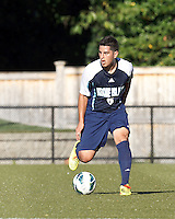 University of Rhode Island (URI) defender Alan Hernandez (6) collects a pass. Boston College defeated University of Rhode Island, 4-2, at Newton Campus Field, September 25, 2012.