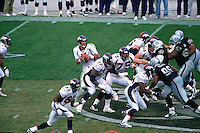OAKLAND, CA - Quarterback John Elway of the Denver Broncos in action during a game against the Oakland Raiders at the Oakland Coliseum in Oakland, California on October 19, 1997. Photo by Brad Mangin