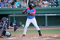 """First baseman Tyreque Reed (38) of the Greenville Drive during a game against the Brooklyn Cyclones on Saturday, May 15, 2021, at Fluor Field at the West End in Greenville, South Carolina. Drive players were wearing jerseys for the """"Ranas de Rio de Greenville"""" (Greenville River Frogs), as part of Minor League Baseball's """"Copa de la Diversion."""" The catcher is Hayden Senger (24). (Tom Priddy/Four Seam Images)"""