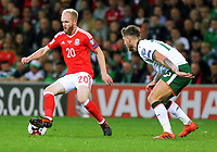 Jonathan Williams of Wales (L) is closely followed by Jeff Hendrick of Ireland during the FIFA World Cup Qualifier Group D match between Wales and Republic of Ireland at The Cardiff City Stadium, Wales, UK. Monday 09 October 2017