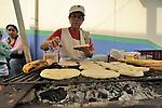Street scenes.Salento, ColombiaCooking Arrepas on a street grill.Salento, Colombia