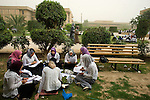 Economics students fit in a last-minute study session for a final exam at the College of Education for Women at Baghdad University, Baghdad, Iraq, Saturday morning, May 29, 2010. Final exams started for tens of thousands of students at Iraq's largest university Saturday. The College of Education for women has 4,000 students required to take a total of 14 exams. During the war and occupation, thousands of students and professors fled Iraq, and problems persist. Most Iraqis can expect six hours or less of electricity per day, unless they can afford a private generator. Traveling to and from the university is complicated by checkpoints and almost daily explosions.
