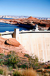 Glen Canyon Dam is a concrete arch dam on the Colorado River in northern Arizona in the United States, just north of Page. The dam was built to provide hydroelectricity and flow regulation from the upper Colorado River Basin to the lower. Its reservoir is called Lake Powell, and is the second largest artificial lake in the country, extending upriver well into Utah. The dam is named for Glen Canyon, a colorful series of gorges most of which now lies under the reservoir