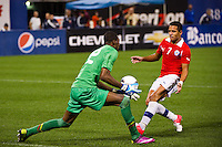 Ecuador goalkeeper Alexander Dominguez (22) grabs a ball intended for Alexis Sanchez (7) of Chile. Ecuador defeated Chile 3-0 during an international friendly at Citi Field in Flushing, NY, on August 15, 2012.