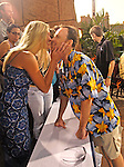 Brook Lyter gets a kiss from his fiancee, Christine, before action against Steve Paul-Ambrose.