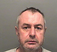 "Pictured: Undated police custody picture of Rhys Hobbs<br /> Re: A man has been jailed for eight years for killing an ex-girlfriend who was found with 41 different injuries.<br /> Andrea Lewis, 51, was found dead at a property on Fairyland Road, Tonna, Neath, on 30 January with injuries to her skull and torso.<br /> Rhys Hobbs, 46, of Tonna, was due to stand trial for murder but pleaded guilty to manslaughter last month.<br /> On Thursday, he was jailed at Swansea Crown Court for the ""violent and protracted"" attack.<br /> The court heard Ms Lewis had been stamped on following a drunken row.<br /> In the weeks running up to her death, she was covered in bruises and had a black eye - but told friends she had fallen."