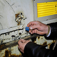 Cataldo Alongi, from logistics section of the EU Parliament, sealing a lorry, destined for Brussels, with documents. Every month thousands of parliament's employees travel back and forth between the three sites of European government in Brussels, Strasbourg and Luxembourg, with their documents following them.