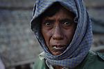 Rakhine man who lives on an ephemeral barrier island inn the Bengal Sea. Rakhine State, Myanmar. January.