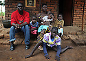 BERTHA CHIKAOUDA WHO LIVES IN THE VILLAGE OF KASARIKA, NEAR LUCHENZA, MALAWI WITH HER FAMILY. HUSBAND GOMESI, 37, EMMA, 7, DANIEL, 1, MONICA, 9, AND CAROLINE, 13, (WHO IS HANDICAPPED). KASARIKA IS AN AIDS COMMUNITY WHICH CARES FOR 45 AIDS WIDOWS AND 111 AIDS ORPHANS. PICTURE BY CLARE KENDALL. 2/11/12