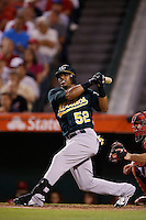 Yoenis Cespedes #52 of the Oakland Athletics bats against the Los Angeles Angels at Angel Stadium on September 10, 2012 in Anaheim, California. Oakland defeated Los Angeles 3-1. (Larry Goren/Four Seam Images)